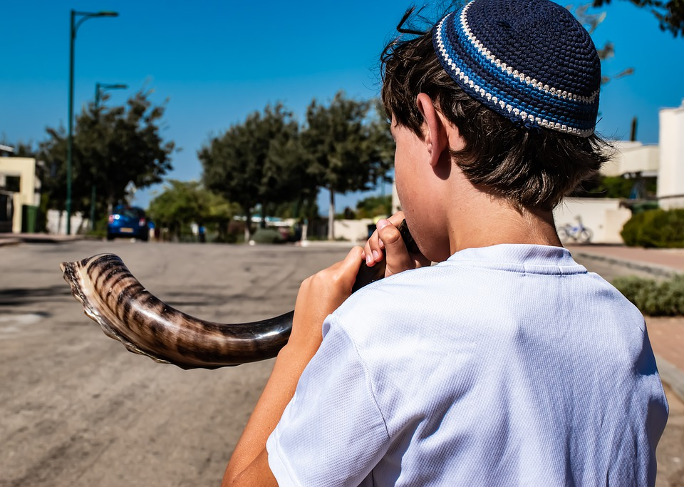 A kid blowing the shofar - a way to open the soul